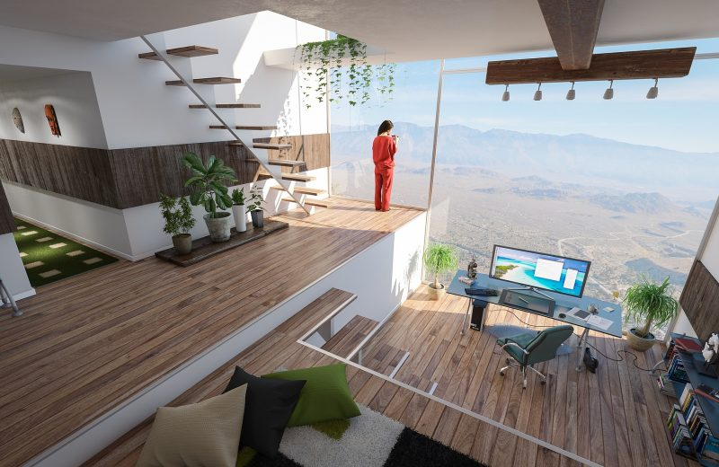 Home office in front of huge window in a modern building overlooking a spectacular view