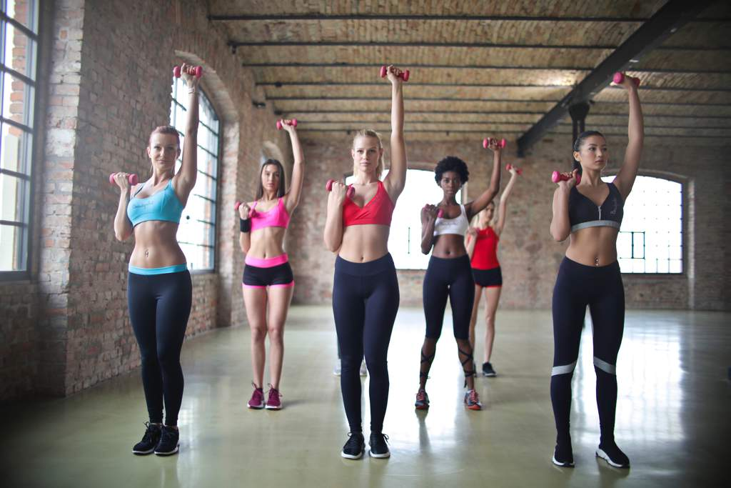 6 women doing aerobics in a gym