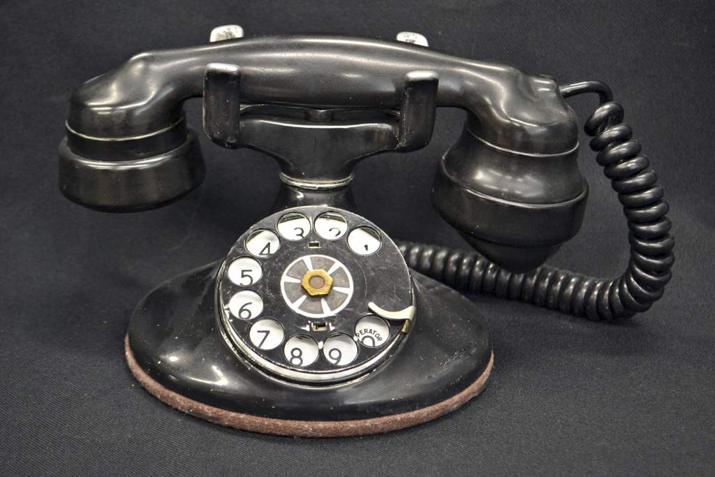 Old fashioned black telephone with rotary dial