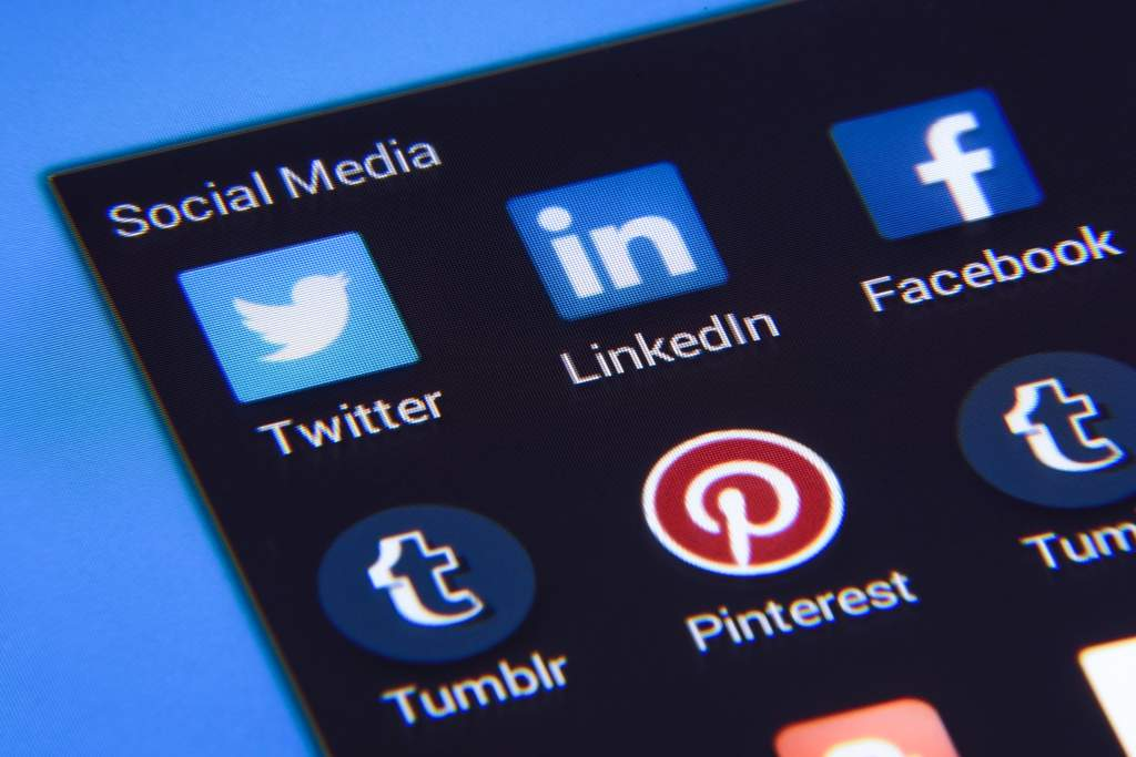 A group of social media icons on a screen, including Twitter, LinkedIn, Facebook, Tumblr and Pinterest