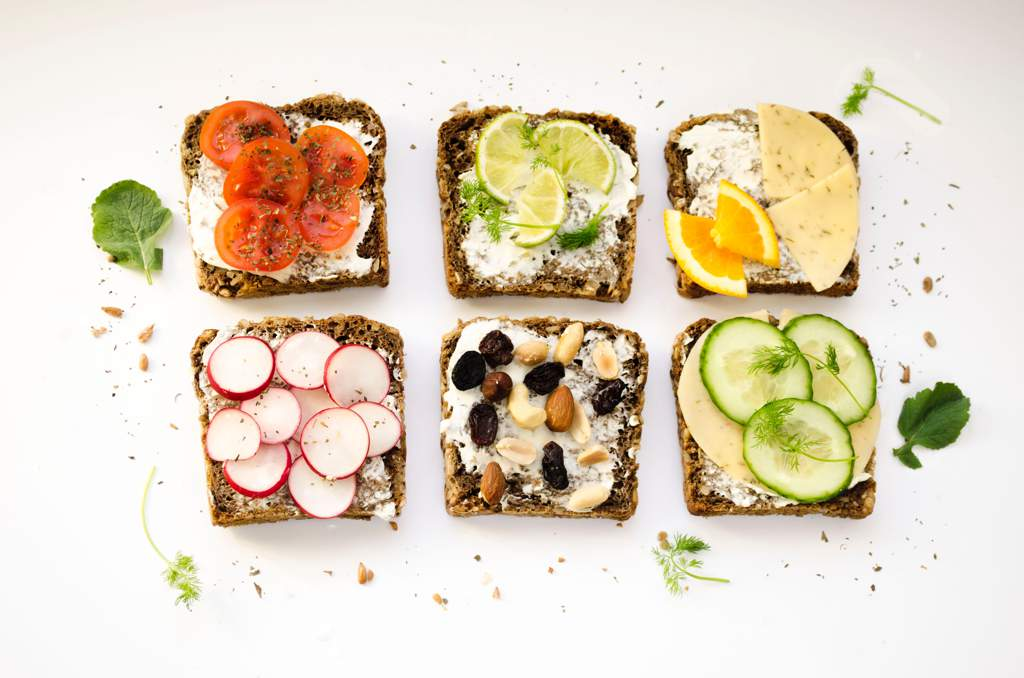Six slices of toast with various healthy toppings.