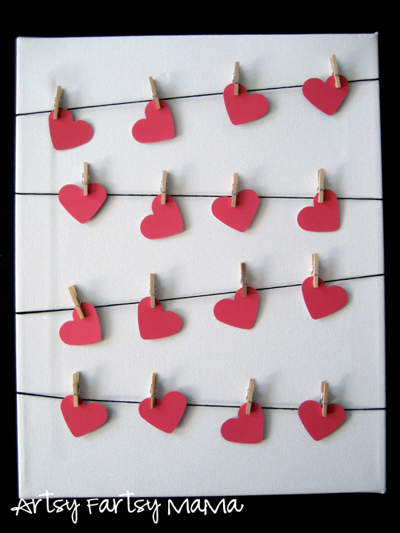 Four rows of red clothes-peg hearts handing on horizontal black lines.