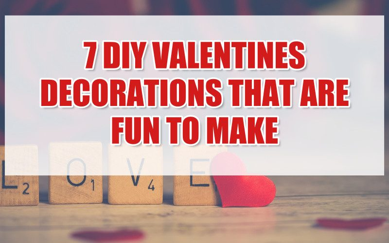 In background, Scrabble tiles spell out LOVE with a red heart leaning against the E. Foreground text reads 7 DIY Valentines Decorations that are fun to make.