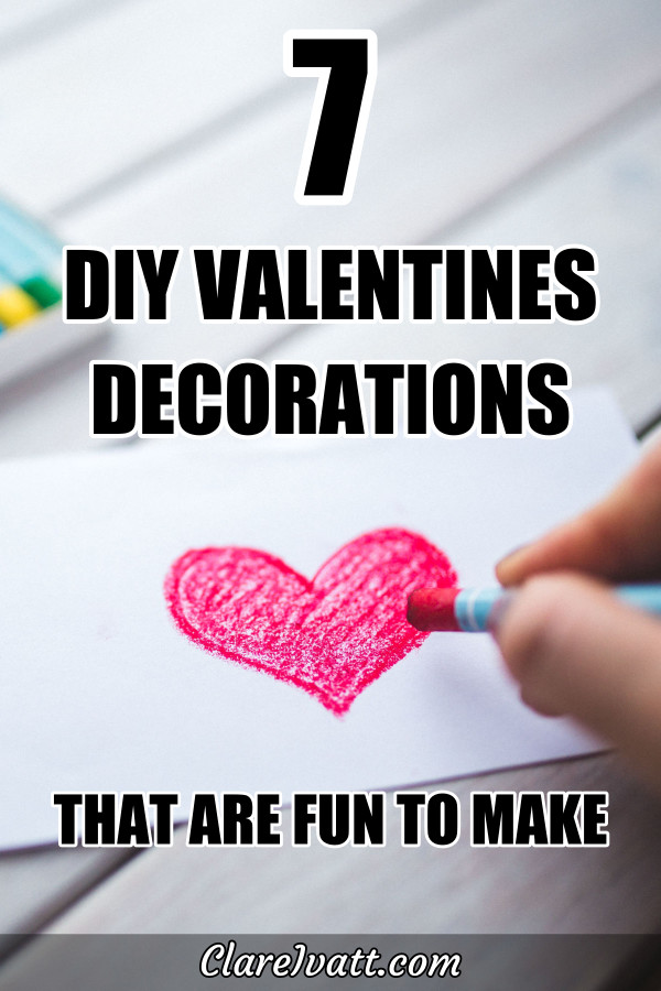 Hand drawing a red heart and coloring it in with a wax crayon. Foreground text reads 7 DIY Valentines decorations that are fun to make.
