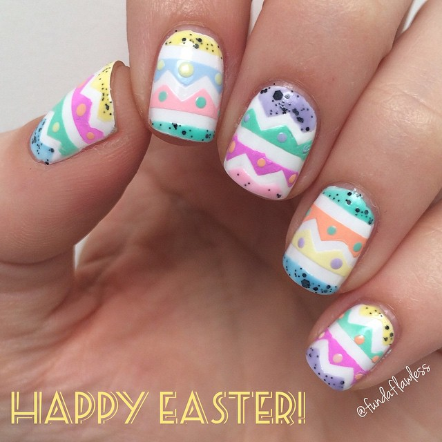 Fingernails with zig-zag patterns, stripes and dots in pastel colors that remind you of an Easter egg.
