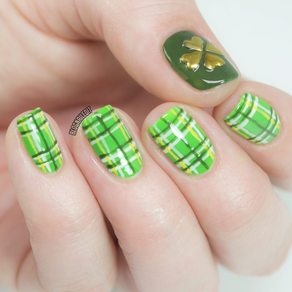 Fingernails with green tartan pattern and a gold shamrock design on the thumbnail