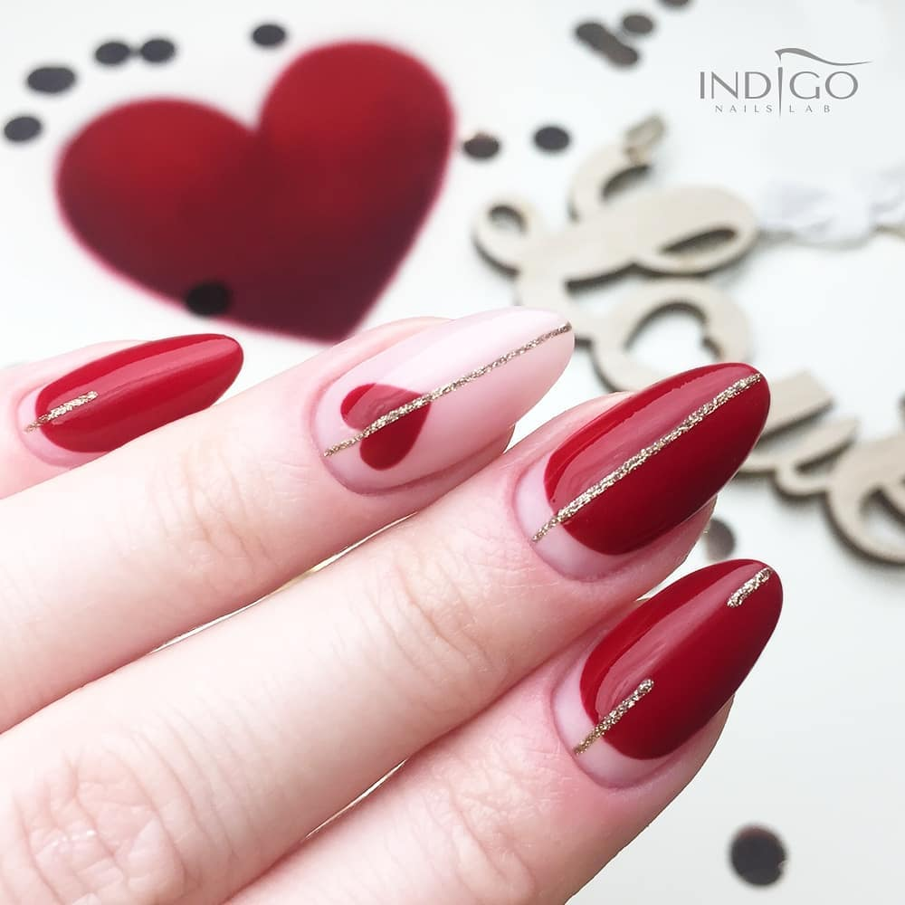 Red nails with glittery silver stripe, one pale pink with a red heart and silver stripe, shown on a white background with a red heart and the word Love.
