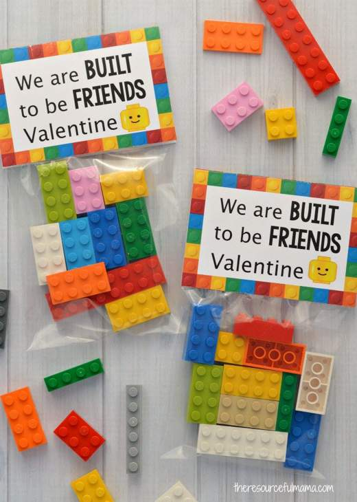 Two small clear bags of lego bricks with printed tops that say We are BUILT to be FRIENDS Valentine.
