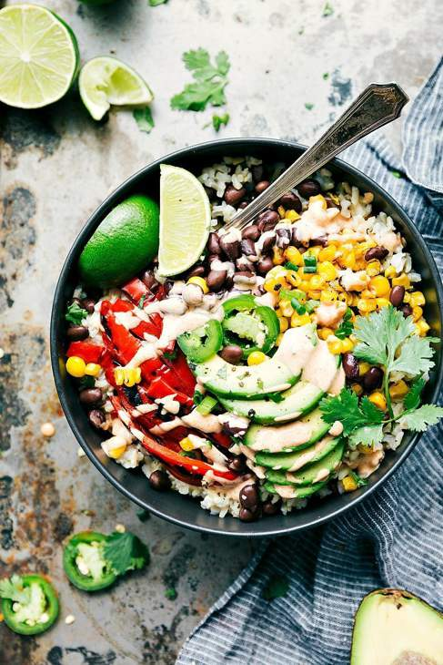 Bowl with limes, avocado, peppers, sweetcorn and more.