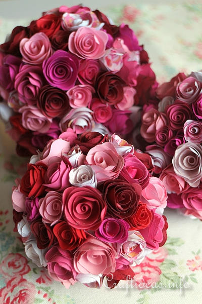 Large bouquets of pink and red paper roses.