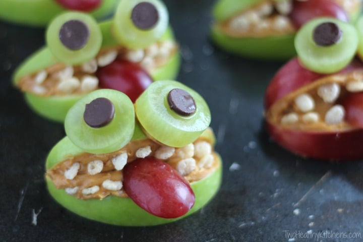 Green and red monsters made from apples and fruit
