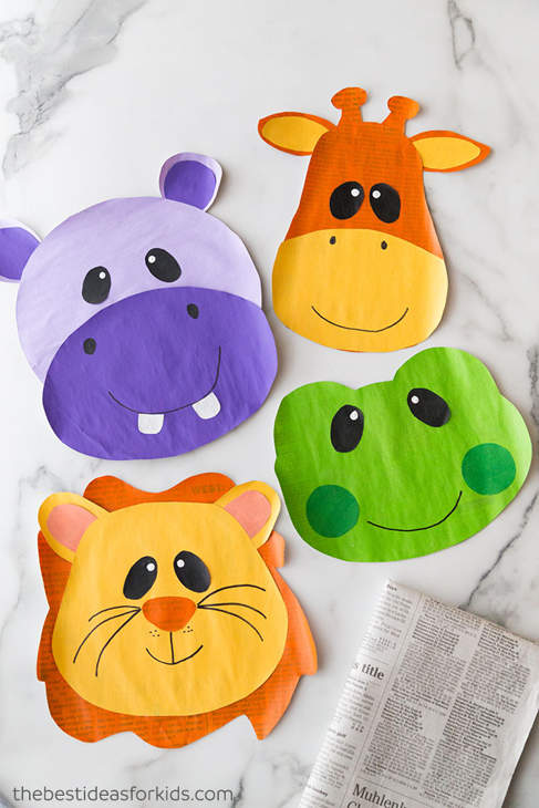 Four brightly-colored zoo animal faces made from painted paper, including a hippo, giraffe, frog and lion.