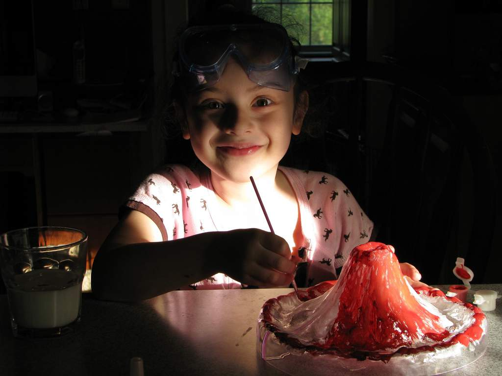 Child making a baking-soda volcano.